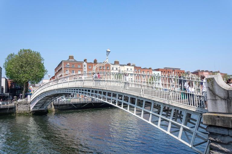 19th century Ha'penny Bridge across River Liffey, Wellington Quay, Dublin.