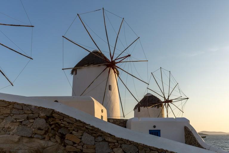 White windmills and Aegean sea on the island of Mykonos