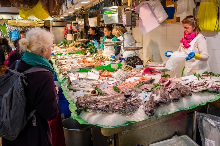 Fresh fish are sold inside the Mercat de la Llibertat