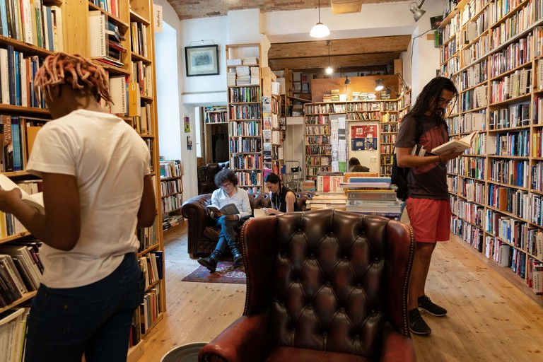 Customers browsing books inside St Georges secondhand bookshop in Prenzlauer berg