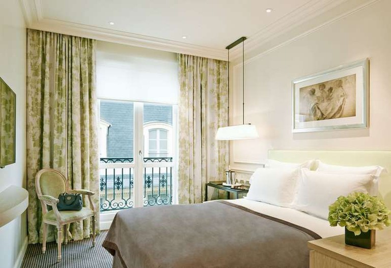 The Grand Hotel du Palais Royal's rooms are bright and airy