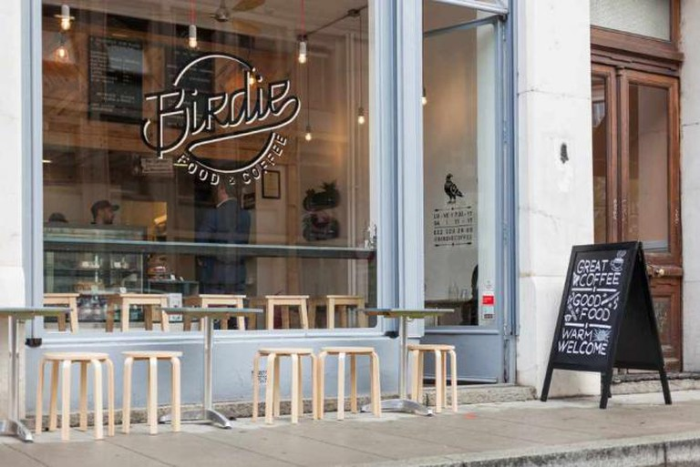 Enjoy a bagel and a cup of coffee at Birdie Food and Coffee