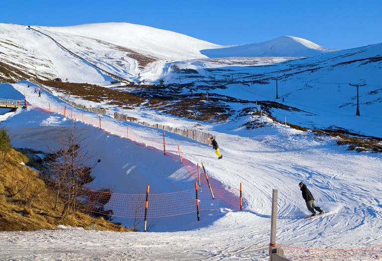 Snowboarders and skiers on Burnside ski run, Cairngorm Mountain Ski Centre, by Aviemore, Cairngorms National Park, Scotland UK. Image shot 02/2013. Exact date unknown.