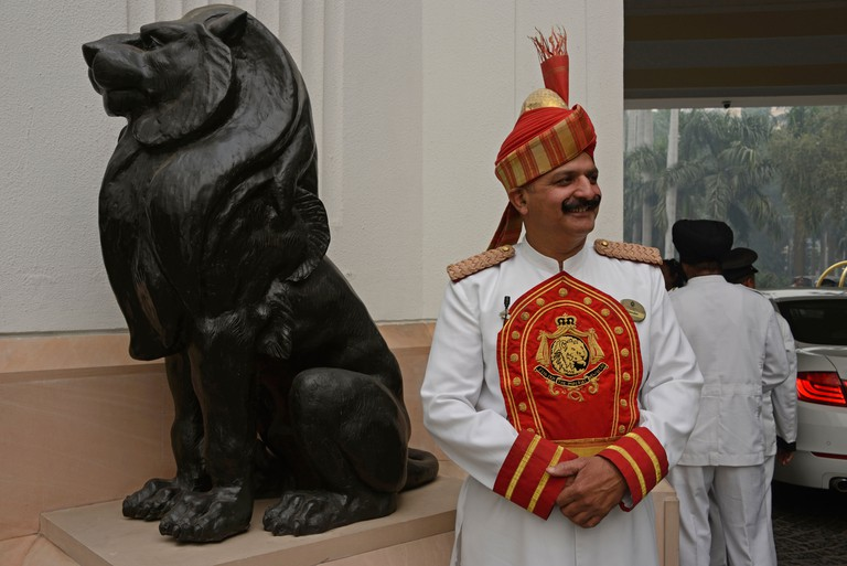 An Indian doorman dressed in Indian styled uniform at Delhi's oldest 5-star hotel, The Imperial in New Delhi, India