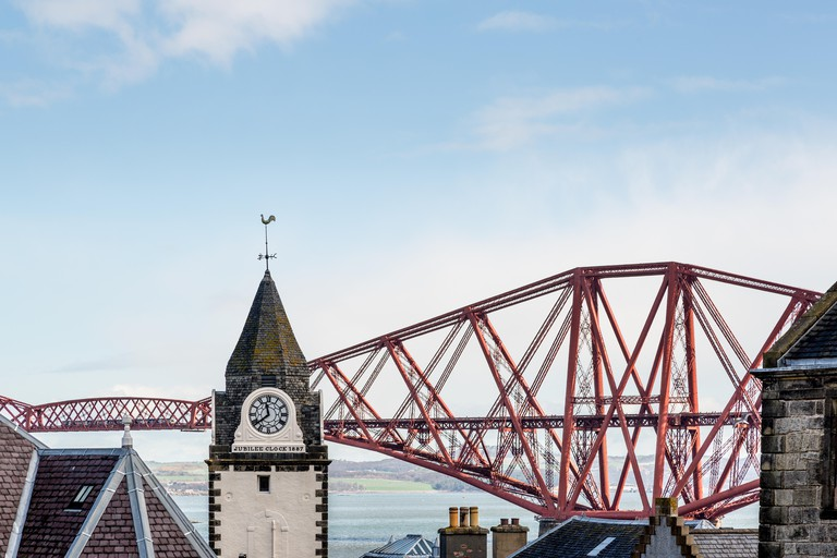 A view from South Queensferry to the Jubilee Clock and Forth Rail Bridge, Edinburgh, Scotland