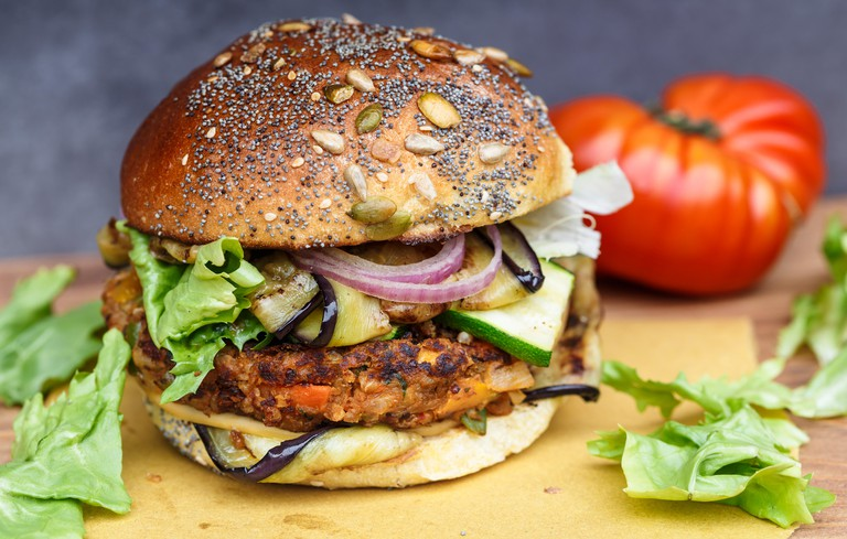 Veggie burger with onion, courgette and aubergine.