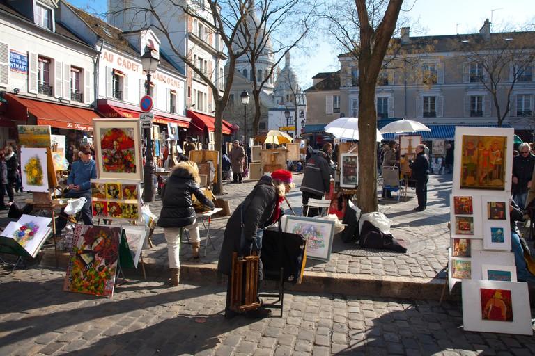 Place du Tertre and painters.Montmartre. Paris, France, Europe.