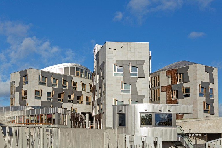 The Scottish Parliament building is made from materials such as Kemnay granite and Caithness flagstone