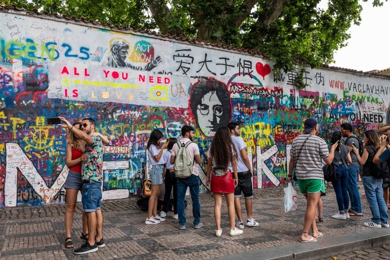 Crowds gather at the John Lennon Wall