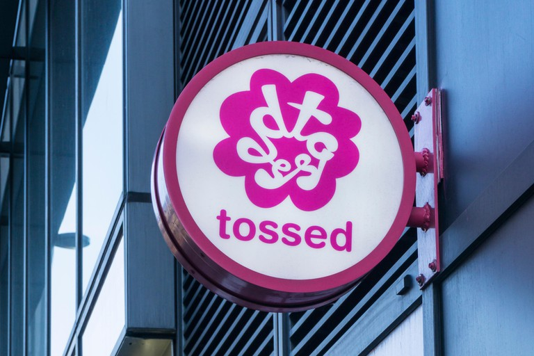 Sign for a tossed salad bar in London.