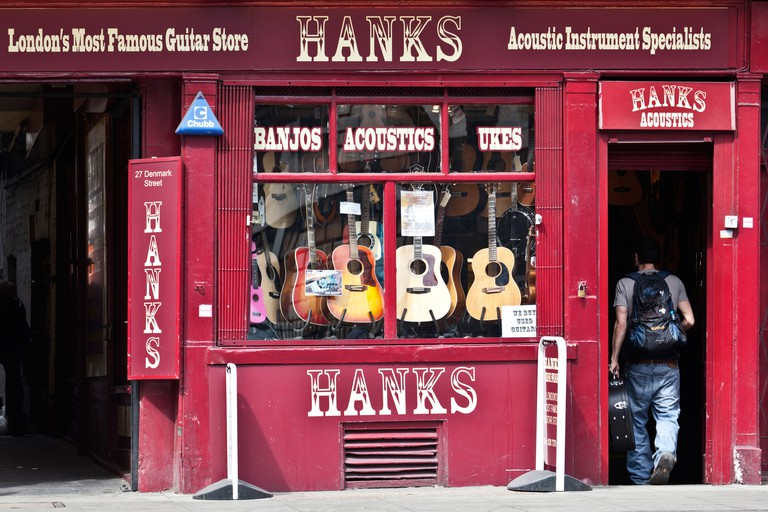 A man entering the famous Hanks guitar store.