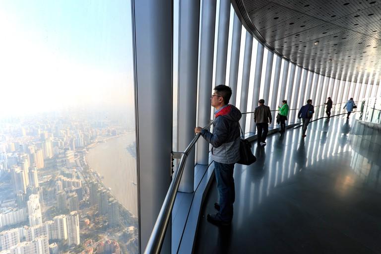 Shanghai, China - March 2, 2017: Tourists enjoying the view of Shanghai from the of the Shanghai Tower