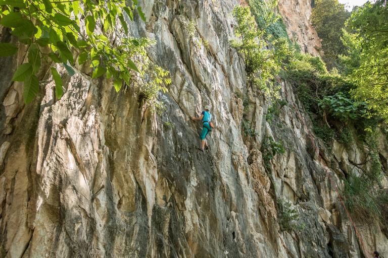 Rock climbers at Batu Caves (Gua Damai) near Kuala Lumpur, Malaysia