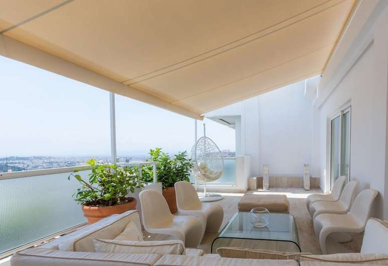 Relax with a drink on St George Lycabettus Hotel's rooftop