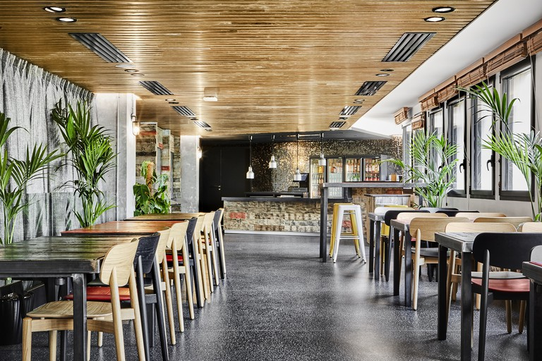 Mingle and grab a bite to eat at the stylish on-site café, Generator Paris, Paris