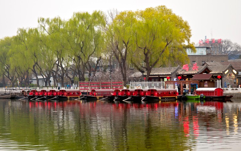 Dinner boats await customers, Shichahai (Houhai) District at Twilight, Beijing, China.