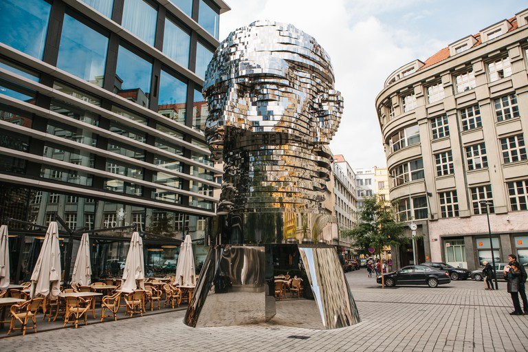 Prague, September 25, 2017: The sculpture of Franz Kafka stands near the shopping center called Quadrio above the metro station, which is called Narod