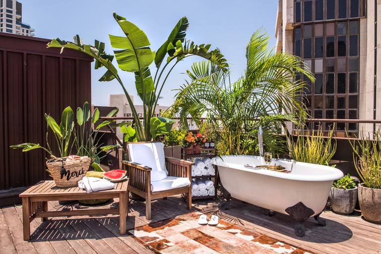 Enjoy a post-treatment dip in the spa rooftop tub with a glass of refreshing prosecco, Brown TLV Urban Hotel, Tel Aviv