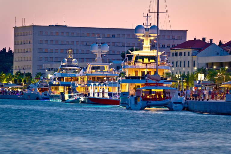 Luxury yachts on Split waterfront evening view. Image shot 09/2015. Exact date unknown.