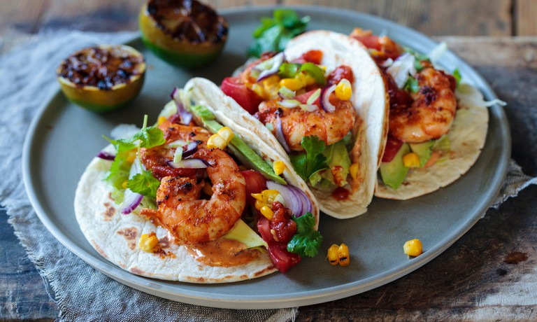 Prawn tacos with avocado and lettuce