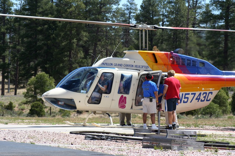 Tourists board a Papillon Grand Canyon Helicopter for an aerial tour of the famous canyon and the Colorado River. Image shot 2006. Exact date unknown.