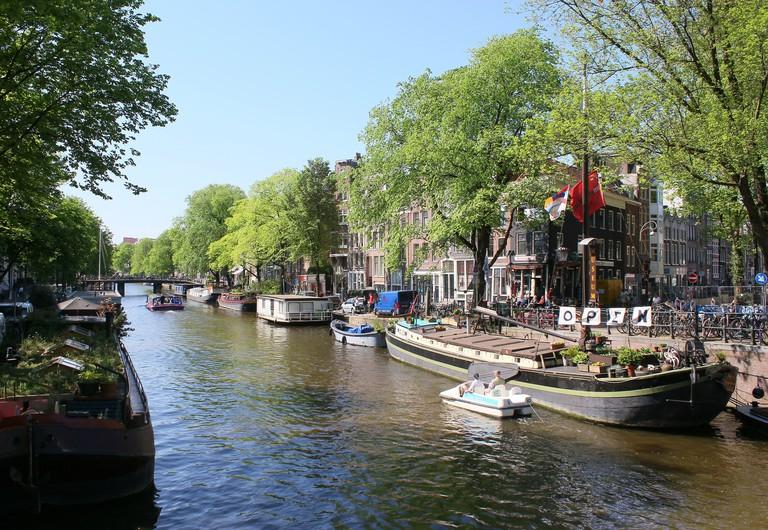 Dutch Houseboat museum (Woonbootmuseum) moored along Prinsengracht canal, Jordaan area, Amsterdam, Netherlands