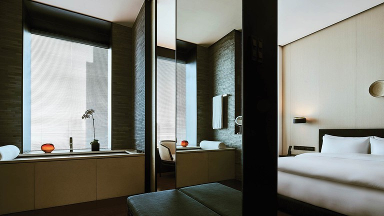 The Deluxe Suite includes an entirely separate master bedroom complete with a marshmallow-like king-size bed. There's also a comfortable lounge area and bathroom, The Puli Hotel and Spa, Shanghai