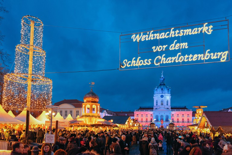 Berlin, Germany - December 9, 2017: Night Christmas Market at Charlottenburg Palace at Winter Berlin, Germany. Advent Fair Decoration and Stalls with