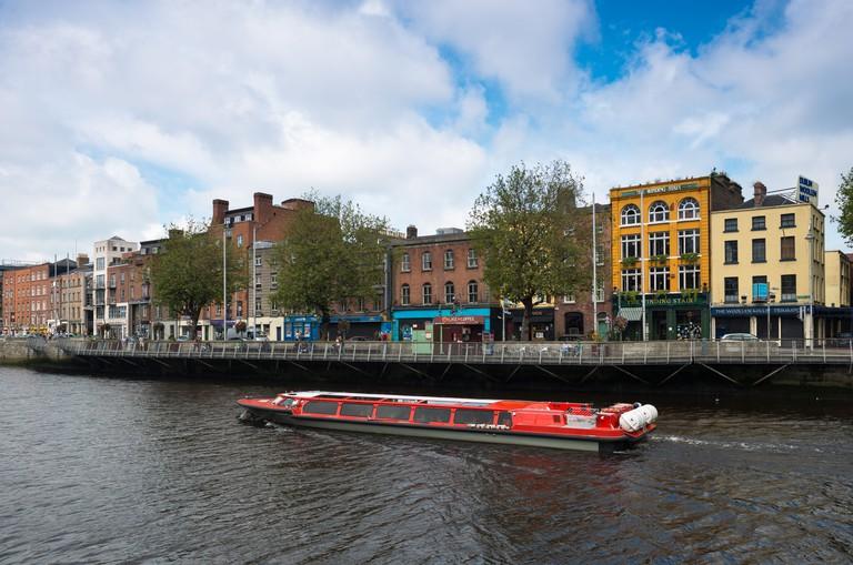 Tourist boat on the Liffey river, Dublin.