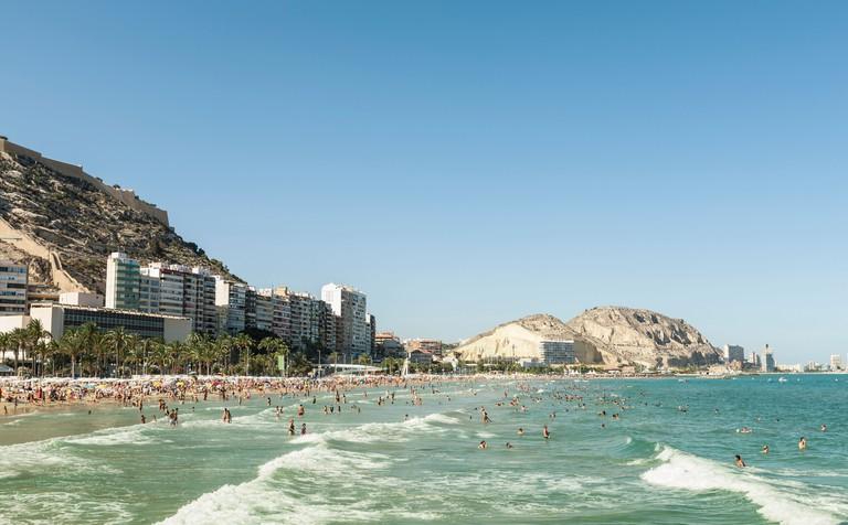 Beachgoers enjoying the summer, Alicante