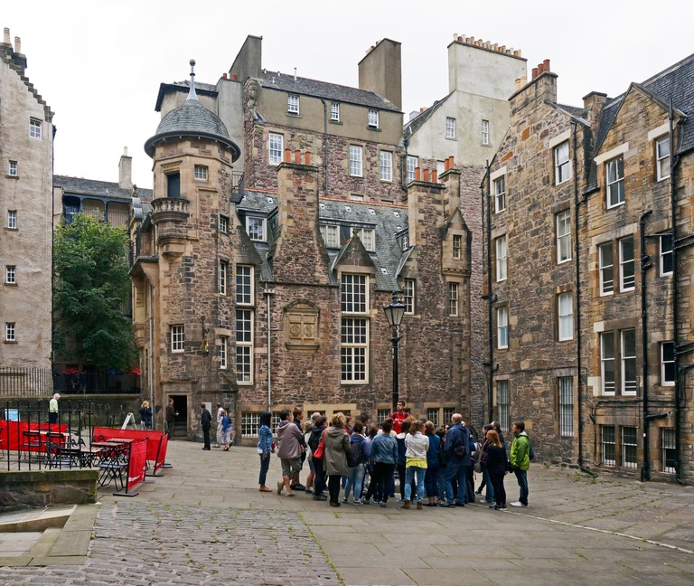 Group of tourists at The Writers' Museum and Makars' Court off The Royal Mile in the centre of Edinburgh Scotland