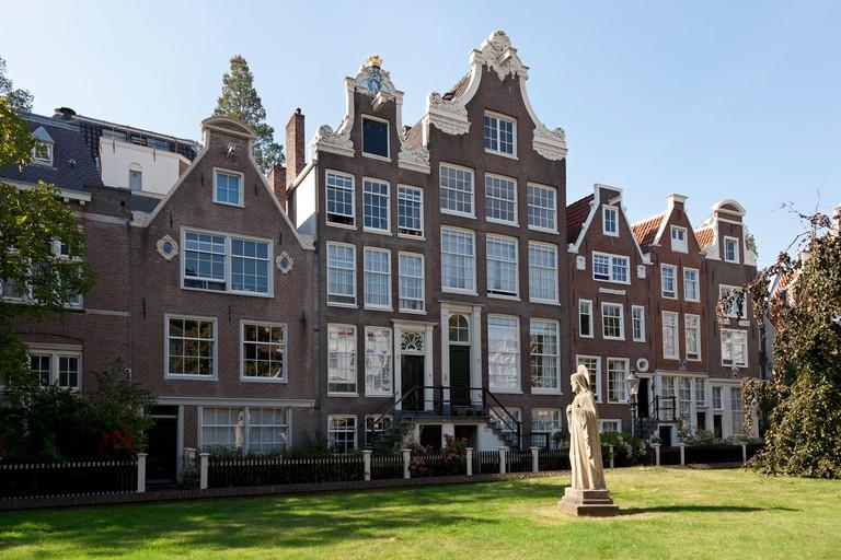 Row of houses in the Begijnhof in Amsterdam, Netherlands.