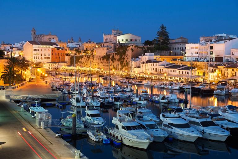 View over harbour and Ayuntamiento de Ciutadella at night, Ciutadella, Menorca, Balearic Islands, Spain, Mediterranean, Europe