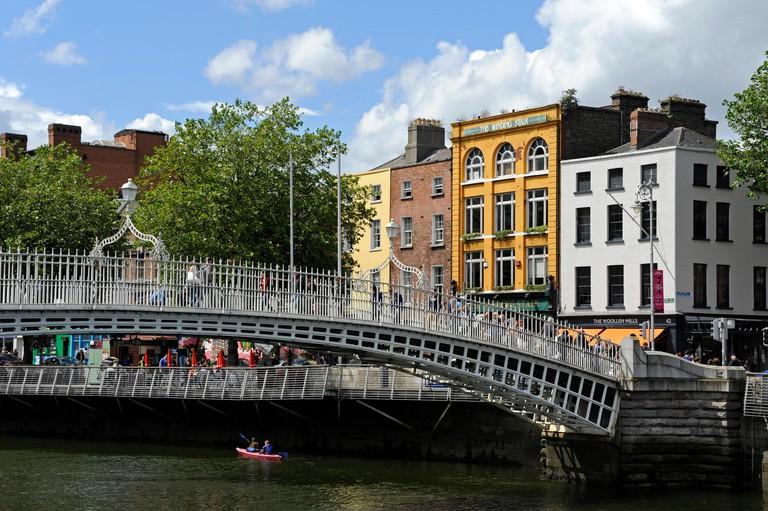 Kayaking underneath the Ha'Penny bridge on the Liffey river, Dublin.