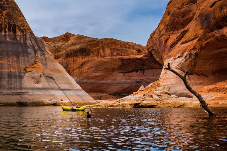 Girl Kayaker exploring beautiful lake Powell Utah-Arizona USA