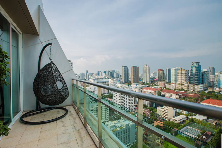 This Airbnb boasts a balcony with dizzying views of the cityscape