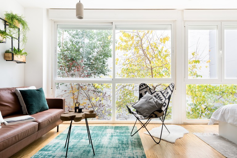 This bright nature-inspired apartment is swathed in green and full to the brim with plants
