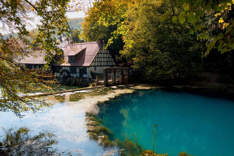 The well Blautopf in Blaubeuren, Germany in autumn