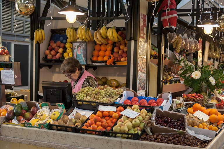 Fruit stall in the Mercado de Campo de Ourique on a quiet Sunday morning