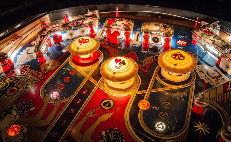 Budapest, Hungary - March 25, 2018: Pinball museum. Pinball table close up view of vintage machine.