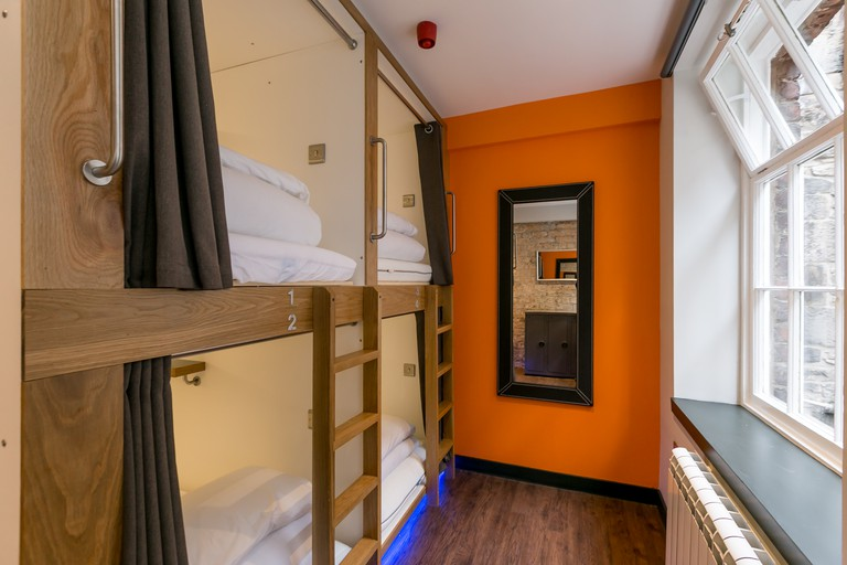 Dorm beds feature a curtain to pull across for optimum privacy