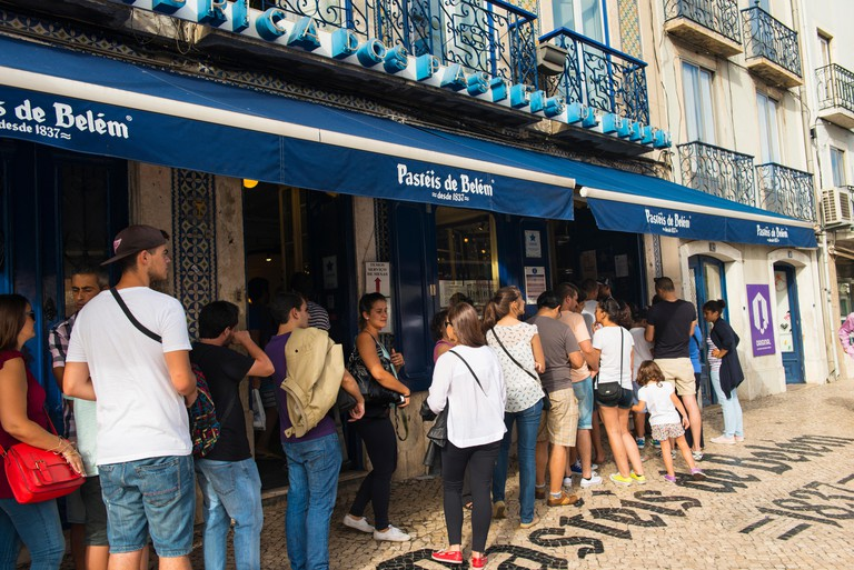 People queue outside the Pasteis de Belem bakery in Lisbon