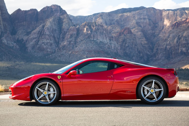 Ferrari 458 Italia in Rosso Corsa Red against the mountains of Red Rock Canyon in Las Vegas