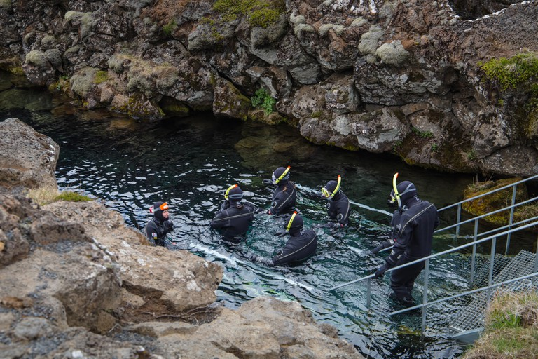 Snorkelling at Silfra rift, Thingvellir Lake in the Pingvellir National Park in Iceland.