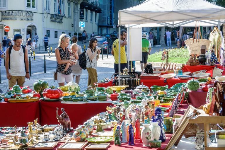Portugal, Lisbon, Avenida Da Liberdade, Sunday flea market, antiques fair, vendor vendors seller sellers sell selling, stall stalls booth booths deale