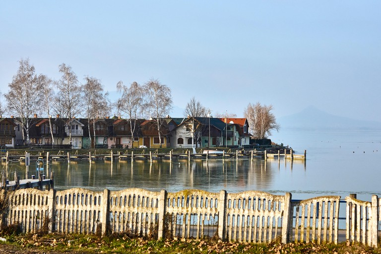 a view of buildings and villages on the banks of lake balaton, hungary