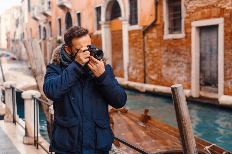Tourist taking photos in Venice