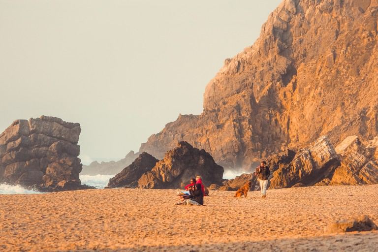 Adraga beach, sunset colors, in Sintra, Portugal. Explore the caves at Adraga Beach to catch a glimpse of goose barnacles, a local delicacy