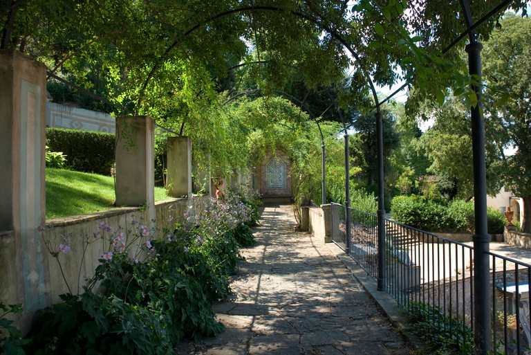 Sun lit passage in Bardini Gardens, Florence, Italy. The Bardini Garden contains many meandering pathways on its hillside location