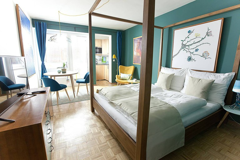 Guests will sleep in luxury in the four-poster bed at this apartment in Karlsplatz